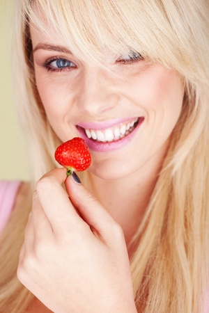 woman eat strawberry very fresh and natural photo