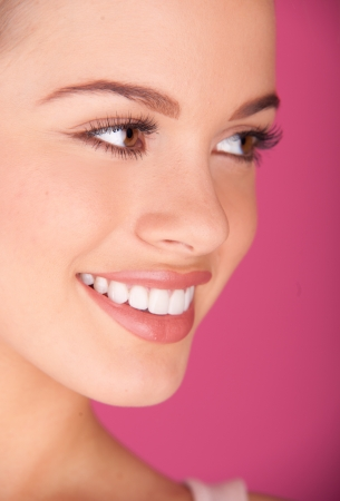 teeth smile: Beautiful young woman  perfect teeth smiling Stock Photo