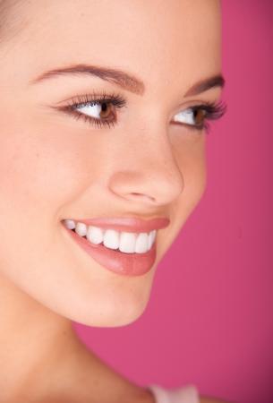 Beautiful young woman  perfect teeth smiling Foto de archivo