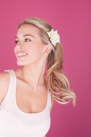 whitening: Beautiful young woman  perfect teeth smiling woman on pink background Stock Photo