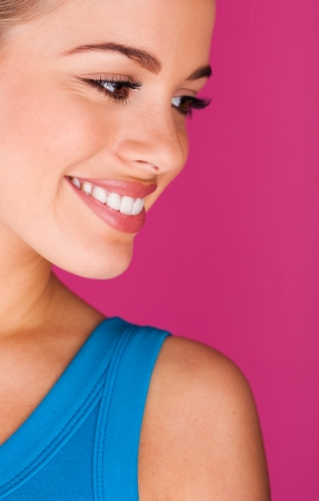 Beautiful young woman  perfect teeth smiling Stock Photo