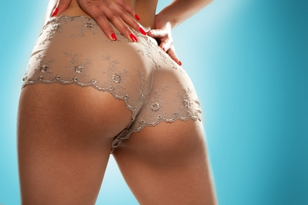 Cropped image of a female models sexy toned buttocks in see-through panties