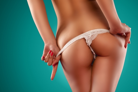sexy women naked: Sensual woman stripping off thong and showing her backside