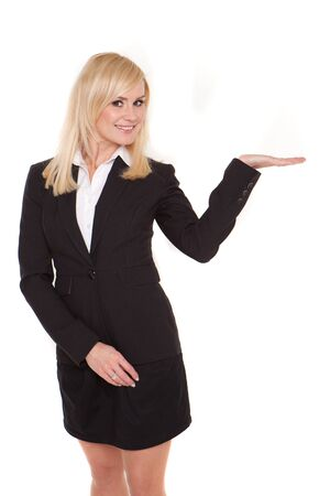 Businesswoman with open palm for product placement facing out of frame and looking back over her shoulder at her hand