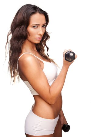 black bra: Fit woman working out with weights holding a pair of dumbbells in her hands with arms flexed