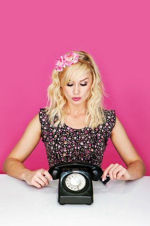 Young woman with old dial up telephone