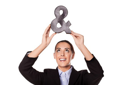 aloft: Beautiful smiling happy businesswoman holding up an ampersand sign symbolic of a new business partner or partnership isolated on white Stock Photo