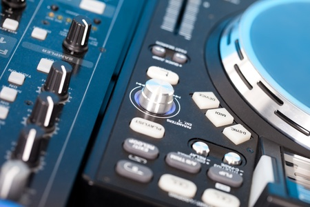 Closeup detail of a DJs music deck with turntable and control knobs for mixing, fading, eqaliser and volume Stock Photo - 16132810