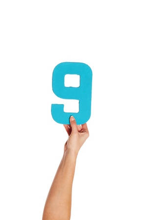 quantity: Female hand holding up the number 8 against a white background conceptual of numbers, measurement, amount, quantity, accounting and mathematics