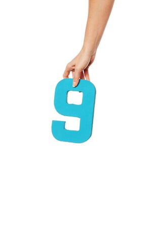 aloft: Female hand holding up the number 8 against a white background conceptual of numbers, measurement, amount, quantity, accounting and mathematics