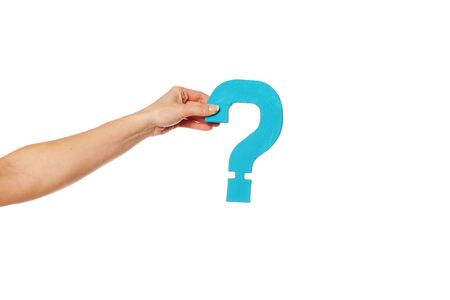 Female hand holding up a turqise question mark against a white background conceptual of questions, query, why or what. Stock Photo - 16147412