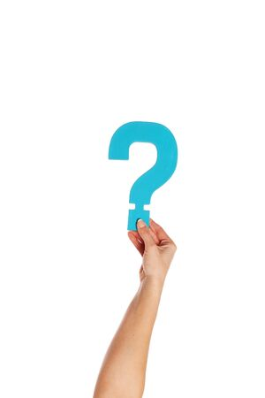 Female hand holding up a turqise question mark against a white background conceptual of questions, query, why or what. Stock Photo - 16147384