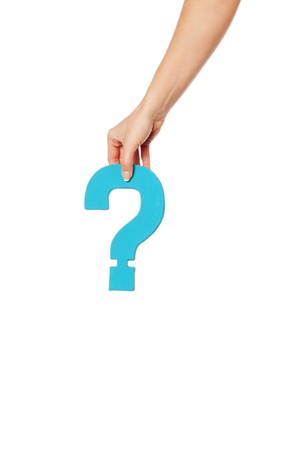 Female hand holding up a turqise question mark against a white background conceptual of questions, query, why or what. Stock Photo