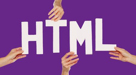 hypertext: Female hands holding the text word for HTML in white capital letters isolated on a purple studio background Stock Photo