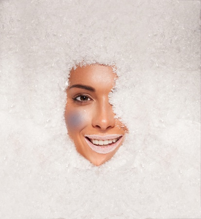 snow maiden: Face of a beautiful woman covered in fresh white winter snow wearing white lipstick reminiscent of a fantasy ice maiden or princess