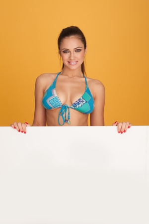 Portrait of a smiling brunette woman in blue bikini bra photo