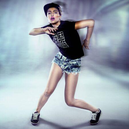dancing club: Young urban woman dancing, club style surroundings Stock Photo