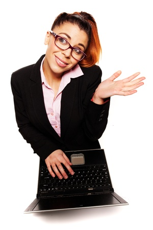 Overhead view of an attractive young businesswoman wearing glasses shrugging her shoulders in indifference or ignorance photo