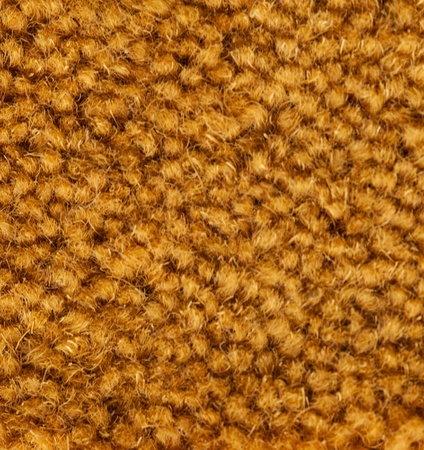 Background texture of a golden carpet with a short pile and rough fibre detail in square format Stock Photo - 21338492