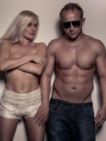 portrait of young fitness couple topless photo