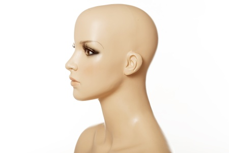 mannequin head: Head of a female mannequin in profile isolated on white
