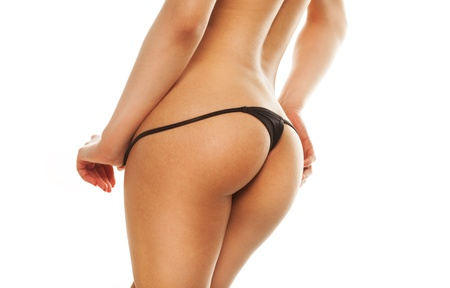 naked lady: Cropped image of female hands seductively caressing bare buttocks in a black sexy g-string