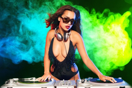 Beautiful DJ girl on decks on the party, Stock Photo