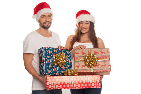 Portrait of couple wit red hat holding Christmas gifts photo