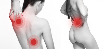 degenerative: View from behind of a young woman with shoulder and back pain stretching back her hand to touch her shoulder blade with red selective colour to the injured areas