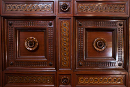 wood carving door: Close up background of carved ornate wooden paneling with floral motifs in high relief