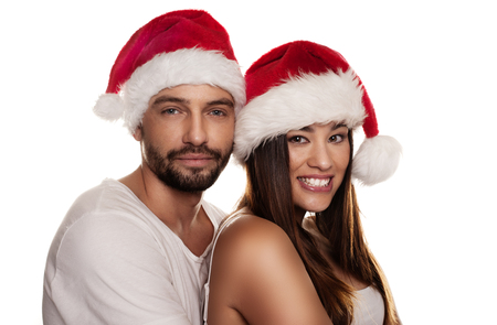 Beautiful couple wearing Christmas hat in a close up portrait photo