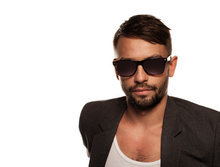 suave: Handsome bearded stylish young businessman wearing sunglasses
