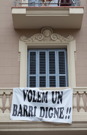 ultimatum: Protest banner hanging off the balustrade on a building facade saying Volem Un Barri Digne, or We Want A Decent Neighbourhood as residents demonstrate regarding their lifestyle and living conditions Editorial