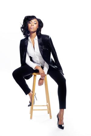 Beautiful African American young woman on white fashionable elegant Foto de archivo