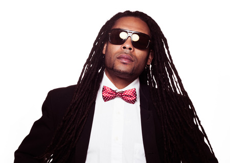 businessman wearing sunglasses and suit dreadlocks Stock Photo