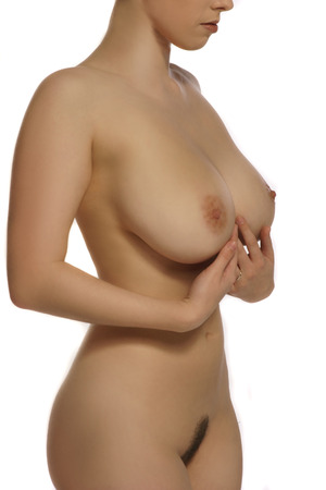 bare breasts: Aesthetic portrait of a beautiful nude female body of a slender curvaceous woman with large breasts and nipples, view from her chin down including the pubic area isolated on white
