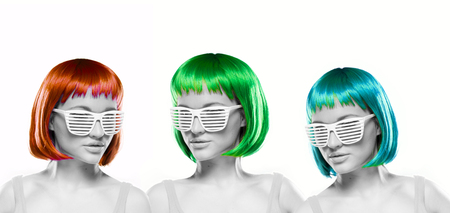 blinder: Trio of beautiful women with bright colorful red, green and blue hair wearing blinder shutter shades or louvered sunglasses Stock Photo