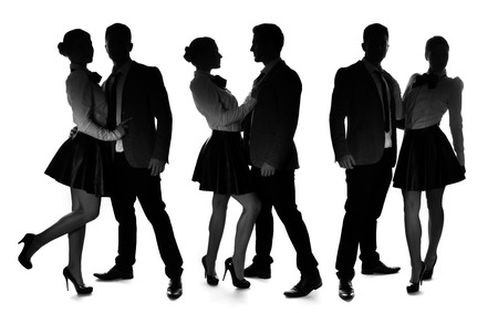 miniskirt: Three silhouettes of a romantic loving couple striking different intimate poses with the man wearing a suit and woman in an elegant miniskirt and stilettos, on white
