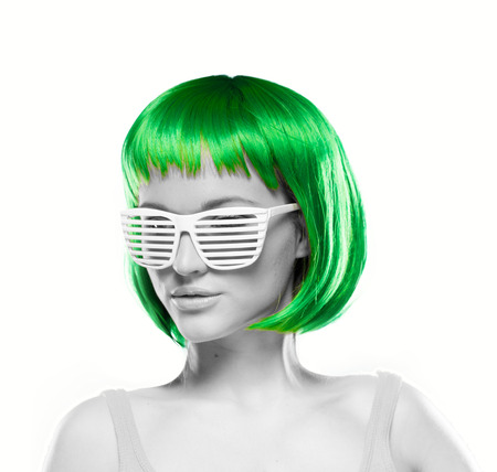 blinder: Young woman with short green hair wearing blinder shutter shades