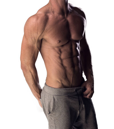 physique: Torso view of an anonymous sexy shirtless man with a toned muscular physique standing with his body turned at an angle isolated on white