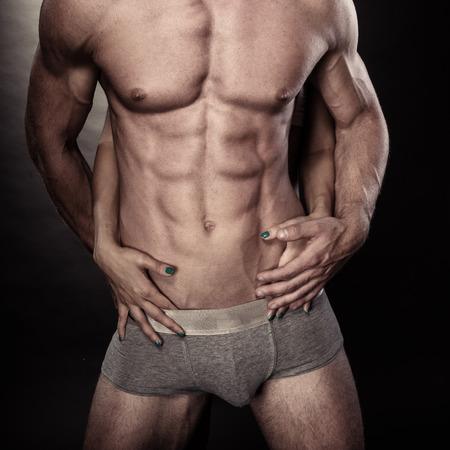 Handsome muscular man shirtless wearing grey pants Stock Photo