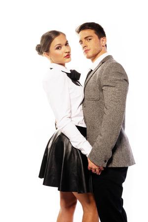 modelos desnudas: Dulce pareja joven en Niza Moda, retrato muy cerca aisladas sobre fondo blanco Foto de archivo