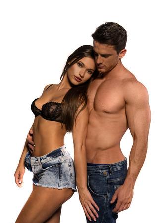 nudo maschile: Due corpi sexy che battono le curve e le righe piacevoli isolate su bianco. Scatto di foto di modo.