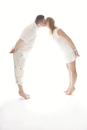 lovely couple: Lovely Couple Wearing All White Clothes Kissing While in Tiptoe.