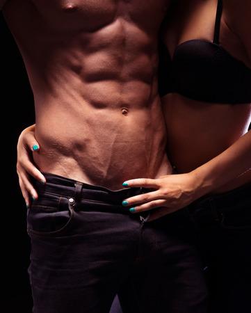 athletes: Organes tr�s sexy Close Up Portrait. Posant pour Fashion Jeans.