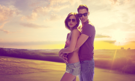 gloaming: Romantic Young Couple on Sunrise Background Portrait