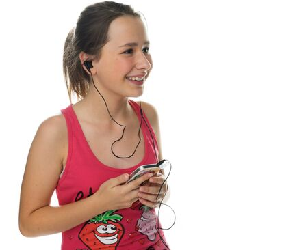 downloaded: Happy young girl enjoying her music smiling with pleasure as she listens to tunes downloaded on an mp3 storage device, on white