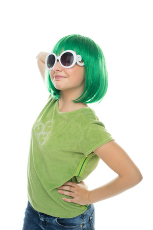 12 13: Cute pretty young girl wearing a bright green wig and sunglasses, isolated on white Stock Photo