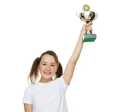 achivement: Young female champion raising trophy looking very happy on white background