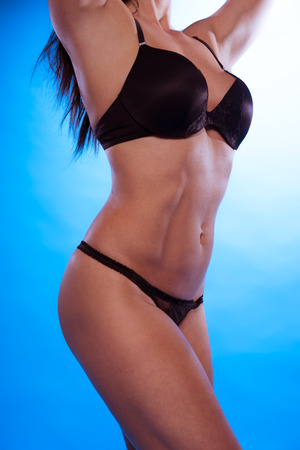 silky lingerie: Sexy Woman Body Curve Wearing Black Underwear Isolated on Gradient Sky Blue Background.